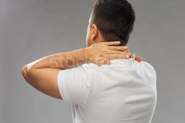 Hombre sufrimiento dolor de cuello personas salud Foto stock © dolgachov