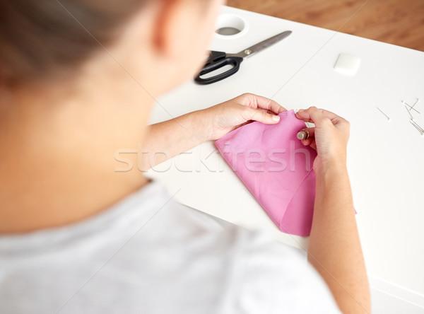 woman with needle stitching fabric pieces Stock photo © dolgachov