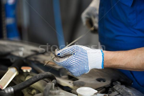 mechanic with dipstick checking motor oil level Stock photo © dolgachov