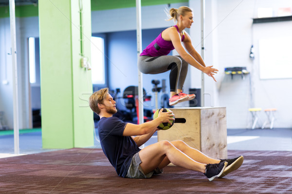 woman and man with medicine ball exercising in gym Stock photo © dolgachov