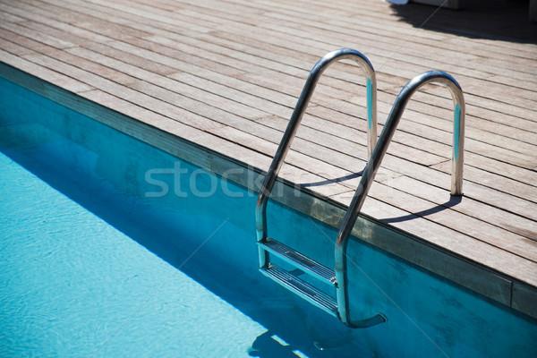 Szabadtér úszómedence létra víz sport nyár Stock fotó © dolgachov