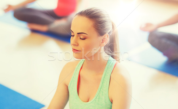 young woman making yoga and meditating in gym Stock photo © dolgachov