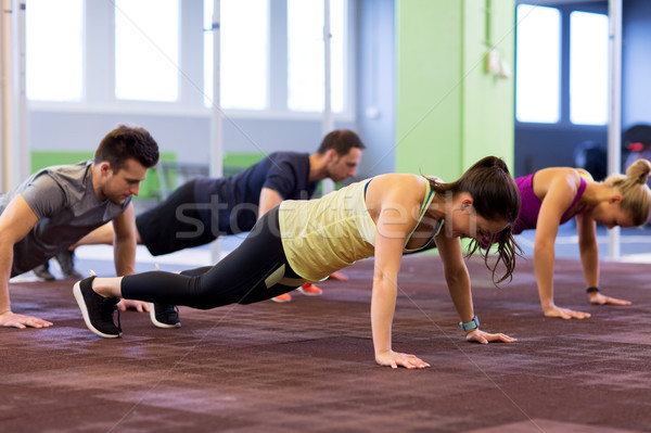 group of people exercising in gym Stock photo © dolgachov