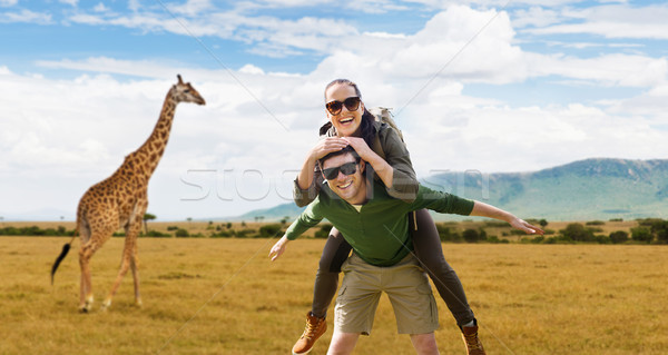smiling couple with backpacks traveling in africa Stock photo © dolgachov