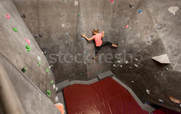 young woman exercising at indoor climbing gym wall Stock photo © dolgachov
