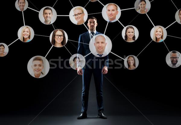 businessman with virtual corporate network Stock photo © dolgachov