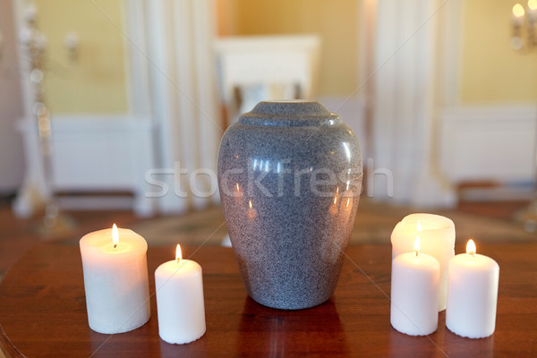 cremation urn and candles burning in church Stock photo © dolgachov
