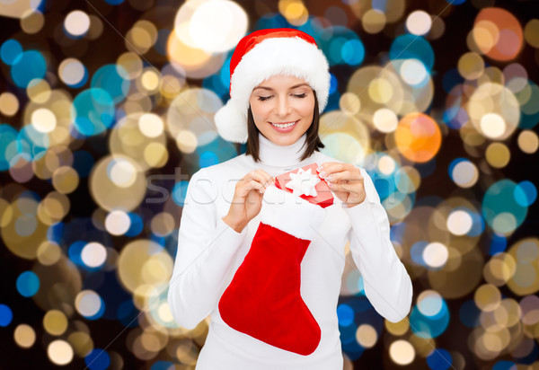 woman in santa hat with christmas gift and sock Stock photo © dolgachov