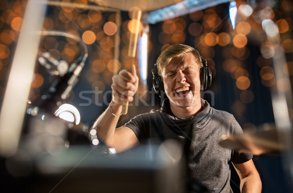 Stock photo: musician playing drum kit at concert over lights