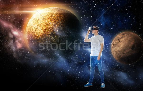 man in virtual reality headset or 3d glasses Stock photo © dolgachov
