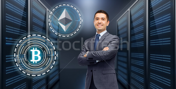 Stock photo: businessman with cryptocurrency holograms