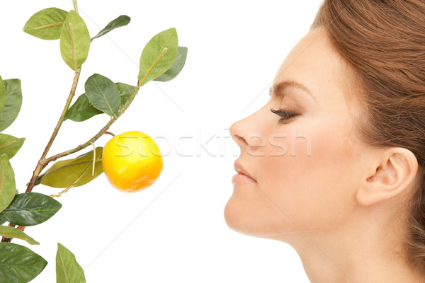 Stock photo: lovely woman with lemon twig