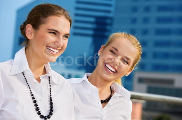 happy businesswomen Stock photo © dolgachov
