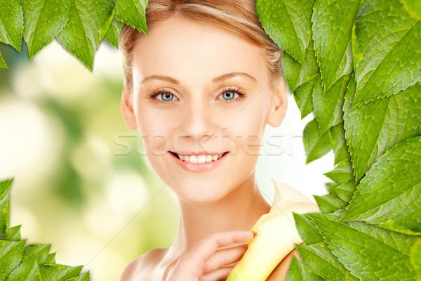 beautiful woman with calla flower Stock photo © dolgachov