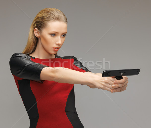 futuristic woman with gadget Stock photo © dolgachov