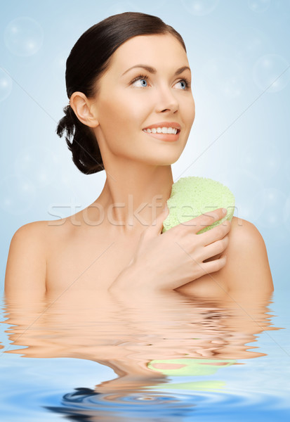 woman with sponge Stock photo © dolgachov