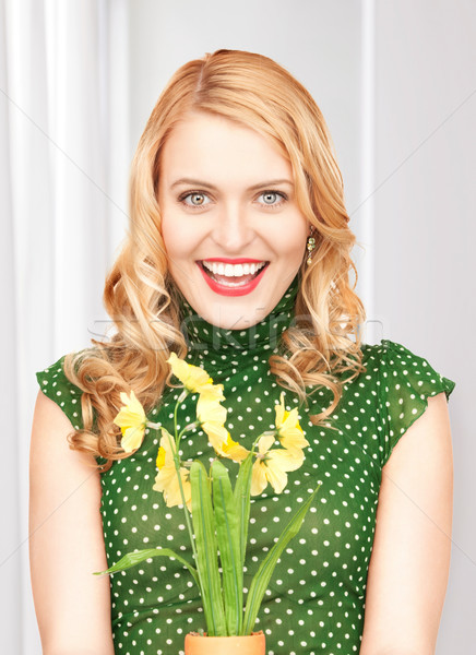 lovely housewife with flower Stock photo © dolgachov