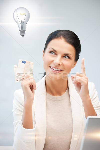 woman with cash euro money and light bulb Stock photo © dolgachov