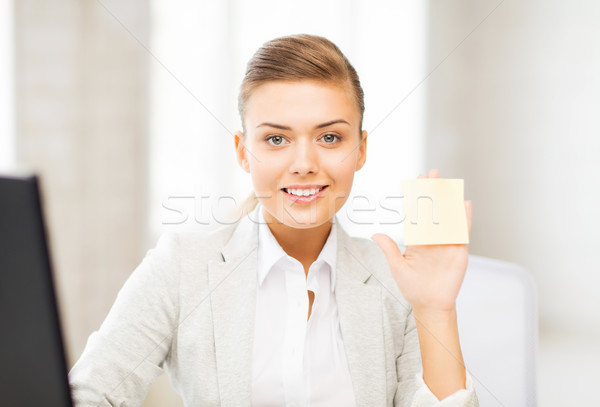 Stock photo: smiling businesswoman showing sticky note