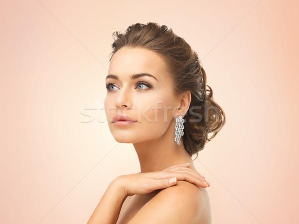 Kobieta błyszczący diament kolczyki Zdjęcia stock © dolgachov