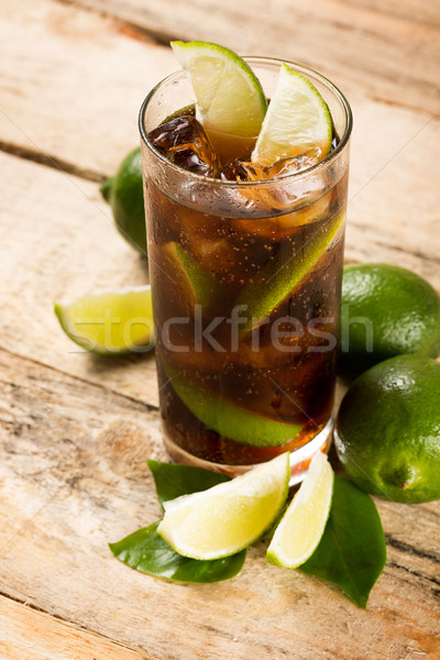 cocktail with cola ice cubes and lime Stock photo © dolgachov