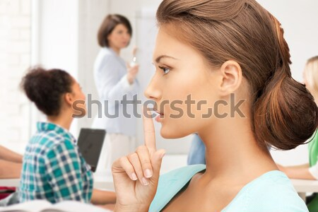 student making hush gesture at school Stock photo © dolgachov