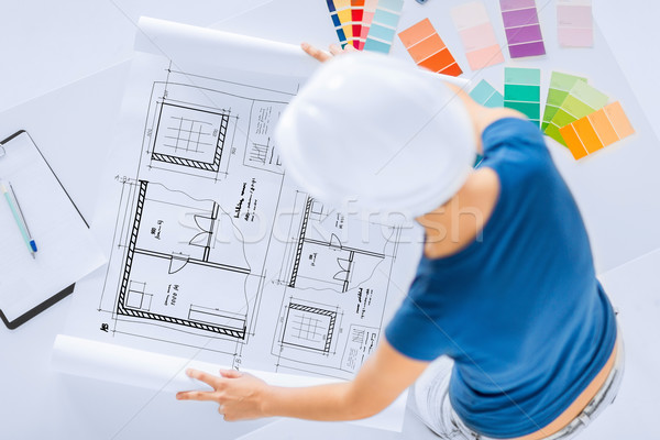 woman with color samples and blueprint Stock photo © dolgachov