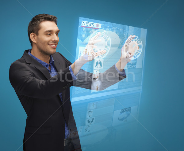 Stock photo: businessman pressing buttons on virtual screen