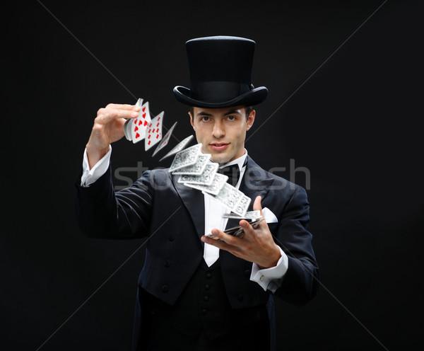 Magicien astuce cartes à jouer magie performances Photo stock © dolgachov