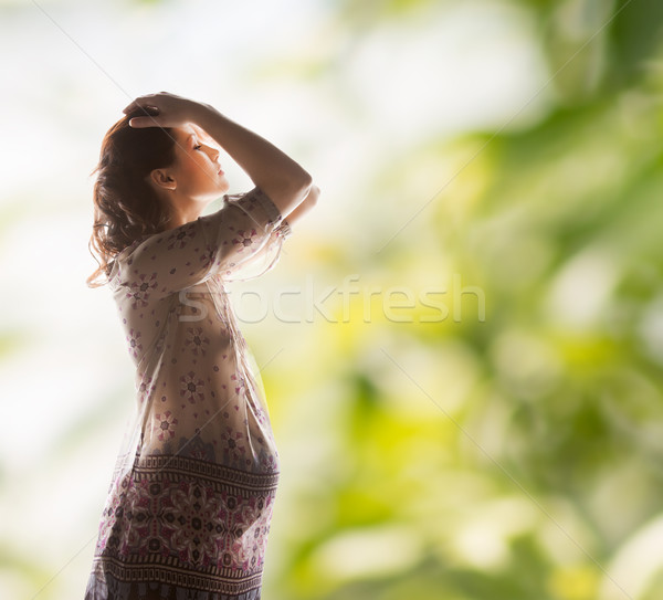Siluet resim hamile güzel bir kadın aile annelik Stok fotoğraf © dolgachov
