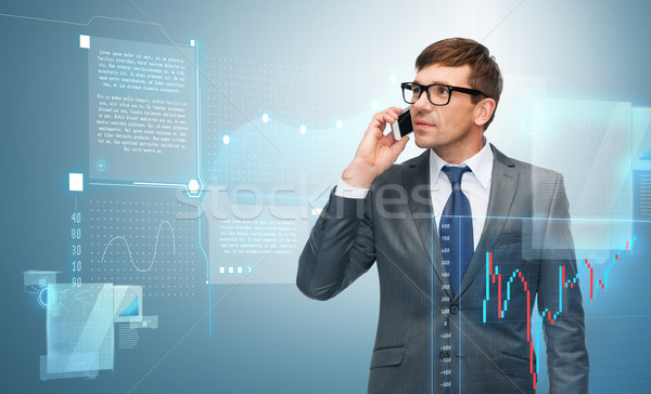 buisnessman with cell phone and forex chart Stock photo © dolgachov