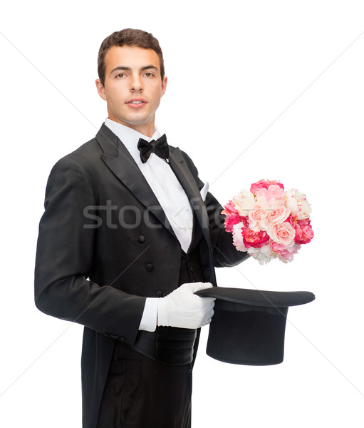 magician with flower bouquet Stock photo © dolgachov