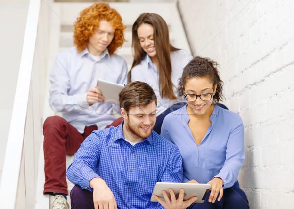 Equipo ordenador sesión escalera negocios Foto stock © dolgachov