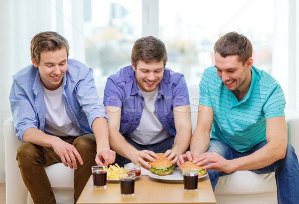 Sonriendo amigos sosa casa amistad Foto stock © dolgachov