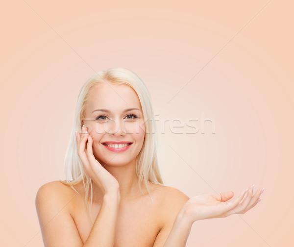 Gülümseyen kadın hayali losyon kavanoz sağlık Stok fotoğraf © dolgachov