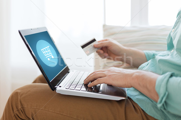 close up of man with laptop and credit card Stock photo © dolgachov