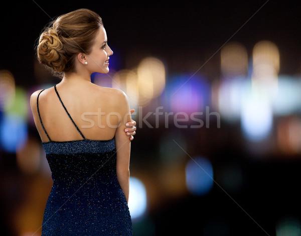 Mosolygó nő estélyi ruha emberek ünnepek báj éjszaka Stock fotó © dolgachov