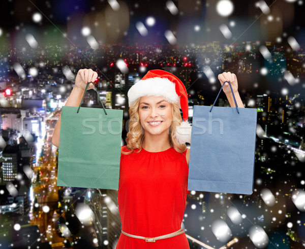 woman in santa helper hat with shopping bags Stock photo © dolgachov