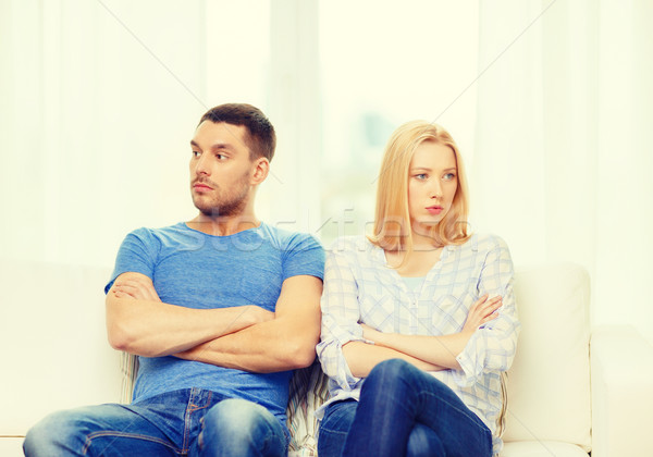 Stock photo: unhappy couple having argument at home