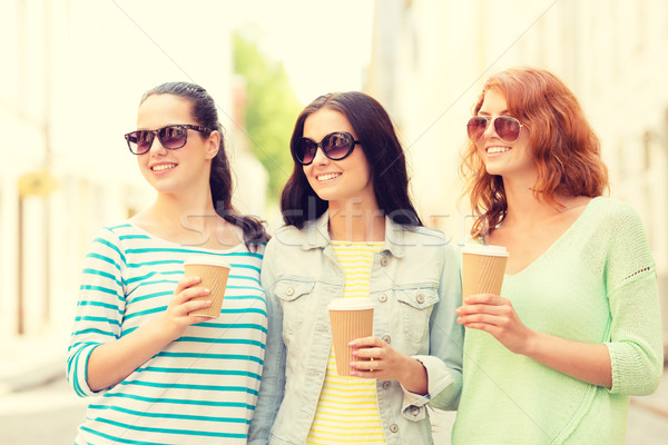 Stock photo: smiling teenage girls with on street