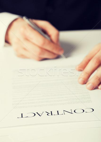Man contract foto handen ondertekening business Stockfoto © dolgachov