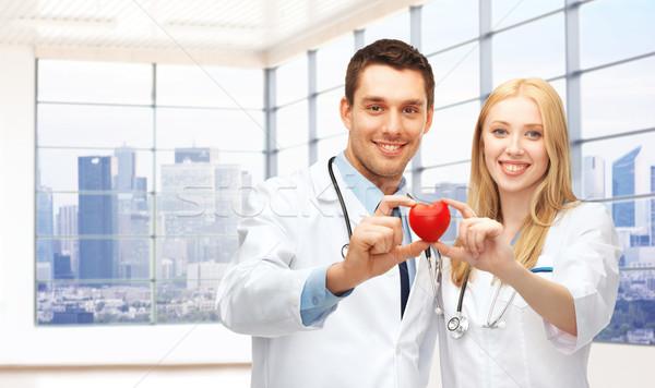 Szczęśliwy młodych lekarzy czerwony serca muzyka Zdjęcia stock © dolgachov