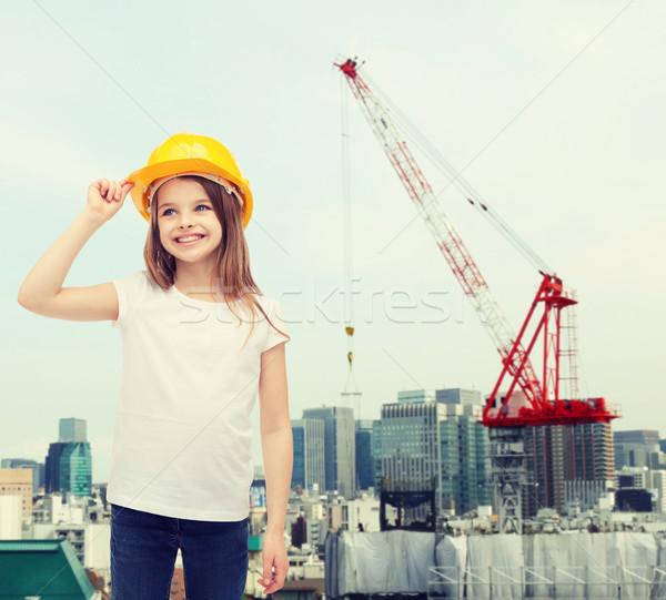 Sorridente little girl capacete construção pessoas Foto stock © dolgachov