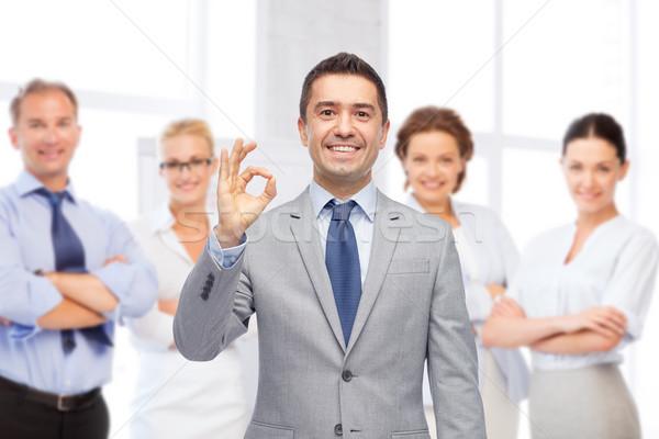 Glücklich Geschäftsmann Anzug Handzeichen Stock foto © dolgachov