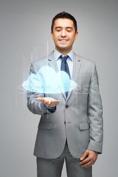 happy businessman showing virtual cloud projection Stock photo © dolgachov