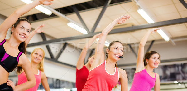 group of smiling people stretching in the gym Stock photo © dolgachov