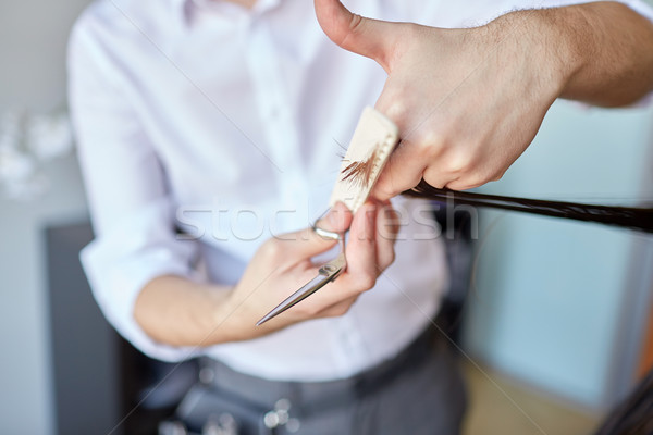 male stylist hands cutting hair tips at salon Stock photo © dolgachov