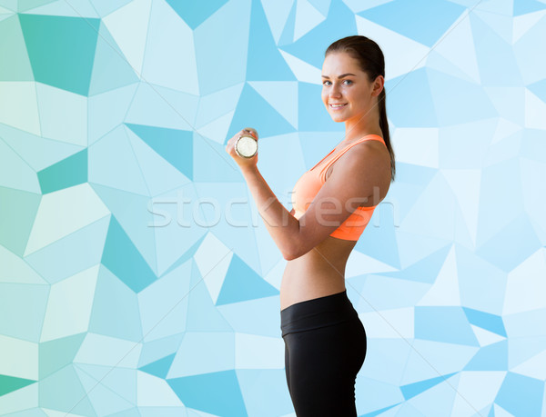 smiling woman with light dumbbell flexing biceps Stock photo © dolgachov