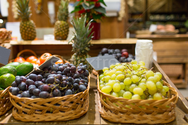 grape in baskets with nameplates at food market Stock photo © dolgachov