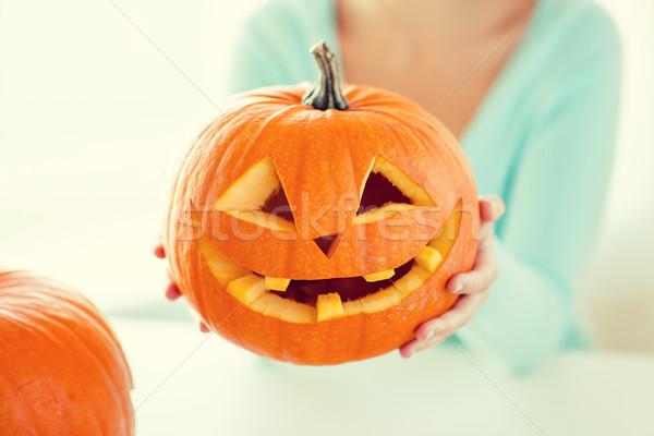 Donna zucche home vacanze halloween Foto d'archivio © dolgachov